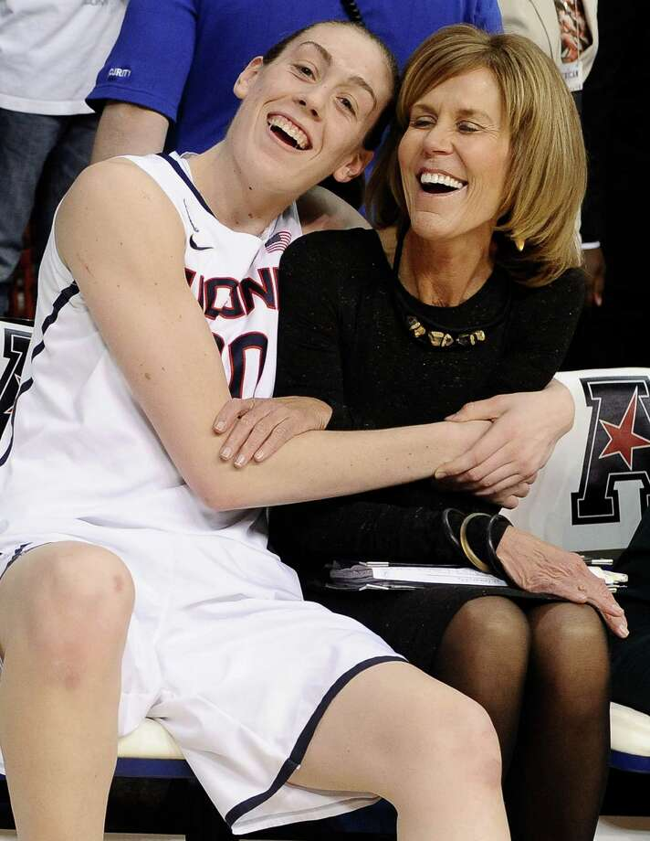Connecticut's Breanna Stewart, left, hugs associate head coach Chris Dailey after winning an NCAA college basketball game in the finals of the American Athletic Conference women's basketball tournament against Louisville, Monday, March 10, 2014, in Uncasville, Conn. Connecticut won 72-52. Photo: Jessica Hill, AP / Associated Press