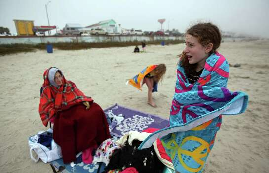 Earline Ischy, 80, stays warm as granddaughter Rachel Satterlee, 11, dries off on a chilly afternoon at the beach during their spring break vacation on Galveston. The National Weather Service said it was 10 degrees cooler then it was at this time last year.See more photos of spring break around the country. Photo: Mayra Beltran, Staff / © 2014 Houston Chronicle