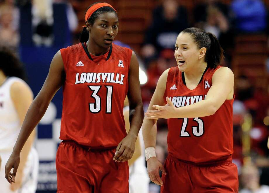 Louisville's Shoni Schimmel, right, talks with teammate Asia Taylor during the second half of an NCAA college basketball game against Connecticut in the finals of the American Athletic Conference women's basketball tournament, Monday, March 10, 2014, in Uncasville, Conn. Connecticut won 72-52. Photo: Jessica Hill, AP / Associated Press