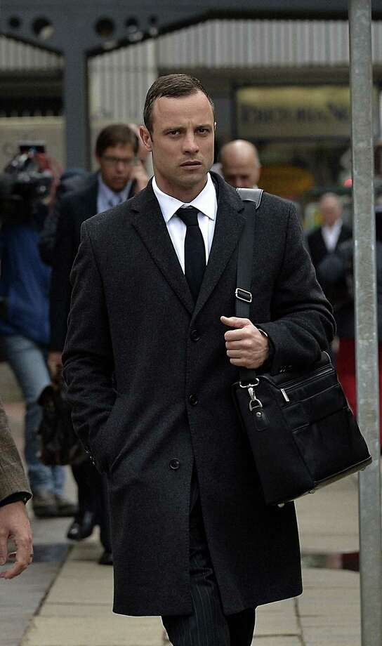 Oscar Pistorius walks to Pretoria's North Gauteng High Court on March 10, 2014, at the start of the second week of the  African amputee Olympian sprinter Oscar Pistorius' murder trial, accused of murdering his girlfriend Reeva Steenkamp. Pistorius, 27,shot his girlfriend Reeva  dead on Valentine's Day 2013 through a locked bathroom door at his home in the city, and faces a life sentence if convicted. AFP PHOTO / ALEXANDER JOEALEXANDER JOE/AFP/Getty Images Photo: ALEXANDER JOE / AFP