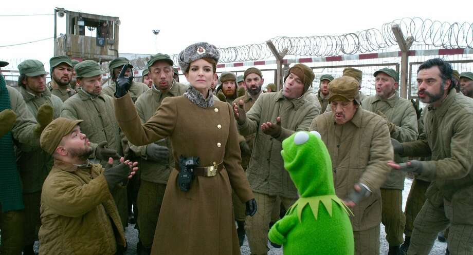 "Tina Fey, above, guards Kermit the prisoner in ""Muppets Most Wanted."" Photo: Walt Disney Studios"