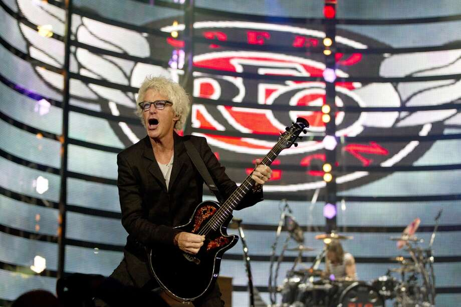 "REO Speedwagon, whose hits included the '80s ballad ""Can't Fight this Feeling,"" rocked the rodeo. Lead singer and rhythm guitarist Kevin Cronin is shown above. Photo: Johnny Hanson, Houston Chronicle"