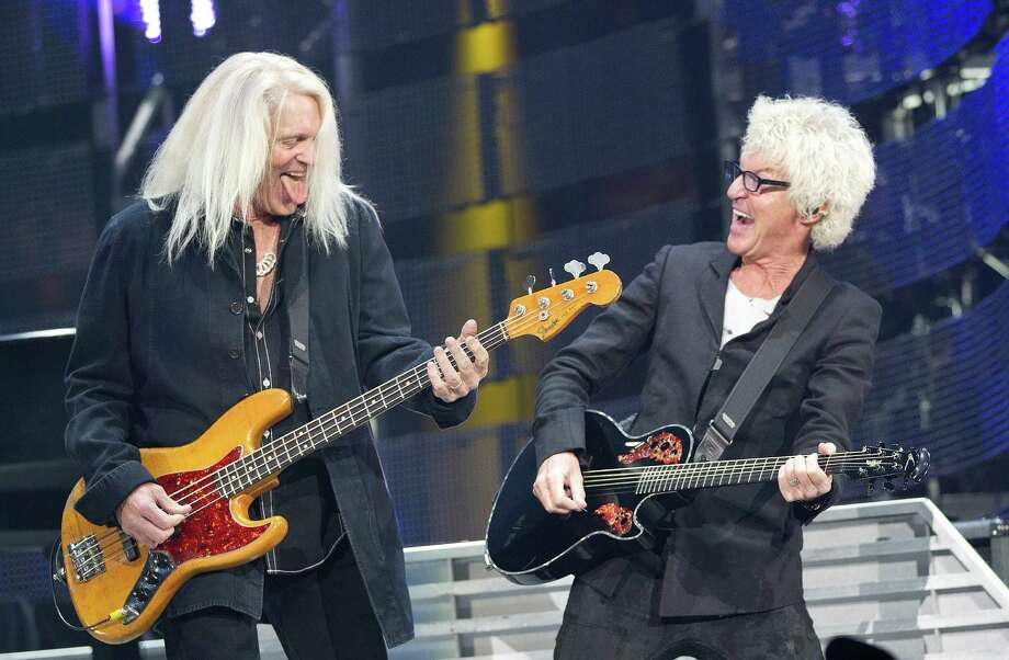 """REO Speedwagon lead singer and rhythm guitarist Kevin Cronin, right, and bassist Bruce Hall enjoyed performing such a """"big gig"""" at Reliant Stadium on Monday. Photo: Johnny Hanson, Staff / © 2014  Houston Chronicle"""