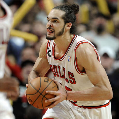 Bulls center Joakim Noah opted not to play with the French national team last summer, but countryman Tony Parker of the Spurs had no problem with that. Photo: Paul Beaty / Associated Press / FR36811 AP