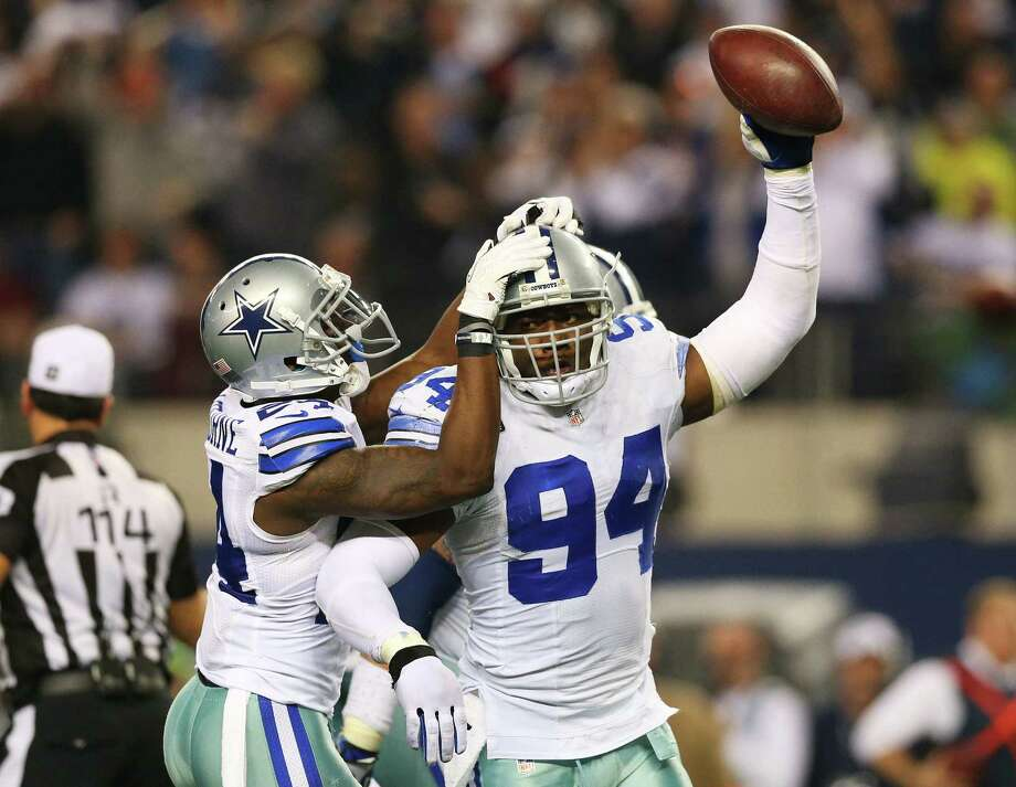 Cowboys defensive end DeMarcus Ware could be released to create room under the salary cap to sign other players. Photo: Ronald Martinez / Getty Images / 2013 Getty Images