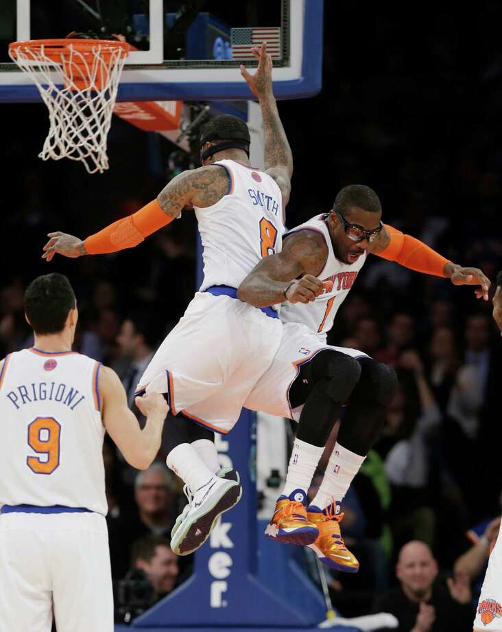 New York Knicks' Amar'e Stoudemire (1) celebrates with teammate J.R. Smith (8) as Pablo Prigioni (9) watches after Stoudemire was fouled while scoring during the second half of an NBA basketball game against the Philadelphia 76ers Monday, March 10, 2014, in New York. (AP Photo/Frank Franklin II) ORG XMIT: MSG117 Photo: Frank Franklin II / AP