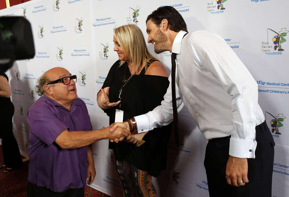 """Lori Puccinelli Stern, center, introduces Danny Devito to Barry Zito on the red carpet at Davies Symphony Hall on Monday, as celebrities arrived for the Painted Turtle and UCSF Medical Center benefit, """"A Starry Evening of Music Comedy, and Surprises,"""" at Davies Symphony Hall in San Francisco, Calif., on Monday, March 10, 2014. Photo: Carlos Avila Gonzalez, The Chronicle"""