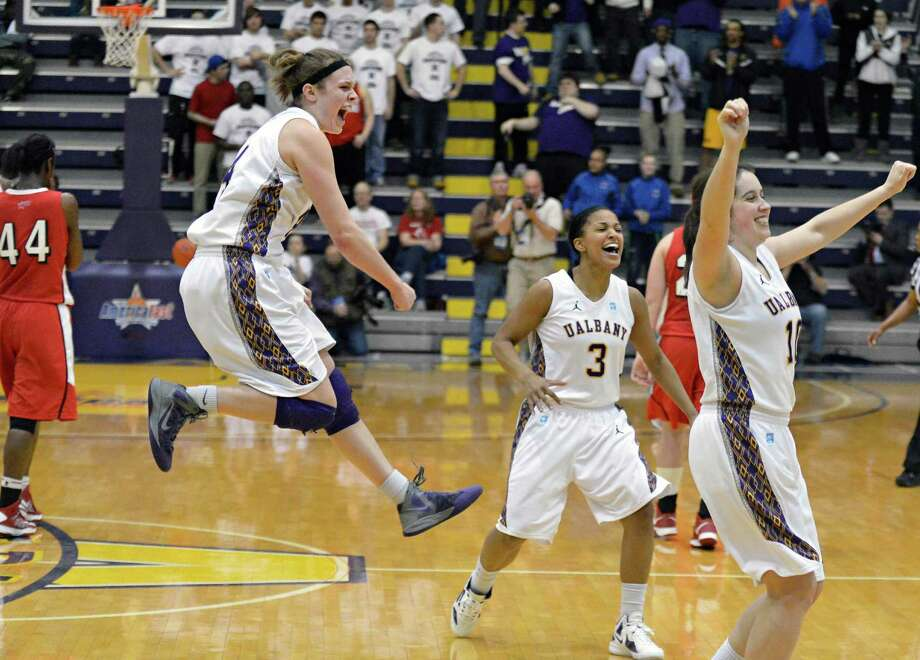 UAlbany women, from left, Sarah Royals, Margarita Rosario and Lindsey Lowrie celebrate with after defeating Hartford  for the America East championship in Albany Saturday March 16, 2013.  (John Carl D'Annibale / Times Union) Photo: John Carl D'Annibale / 00021515A