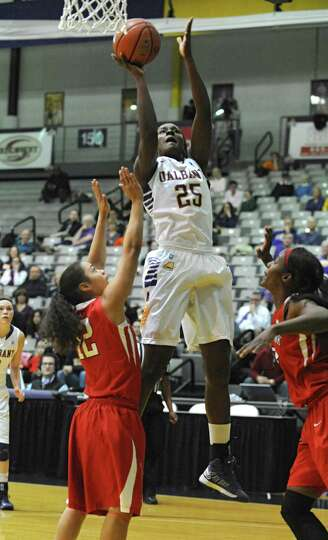 UAlbany's Shereesha Richards shoots over a pair of Stony Brook defenders during the the America East