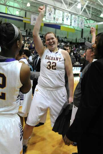 UAlbany's Megan Craig, #32, celebrates with her team after defeating Stony Brook in the America East