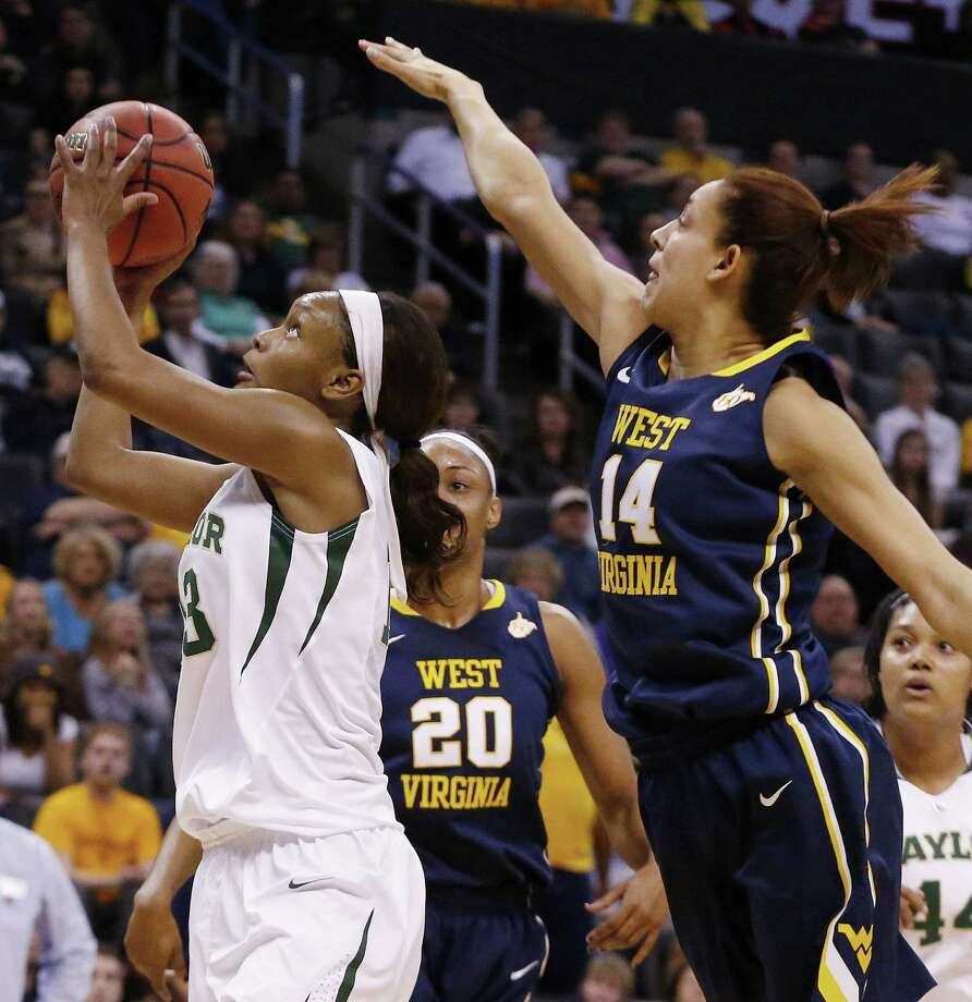 Baylor's Nina Davis, the Big 12 tournament MVP, shoots as West Virginia's Asya Bussie defends. Photo: Sue Ogrocki / Associated Press / AP