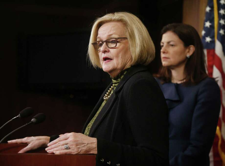 """Sen. Claire McCaskill, D-Mo. (left), said her bill on military sexual assaults means that """"commanders will be held accountable."""" Next to her is Sen. Kelly Ayotte, R-N.H., who helped in a bipartisan compromise to get the bill passed. Photo: Charles Dharapak, Associated Press / AP"""