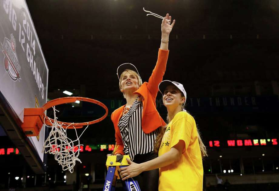 Baylor coach Kim Mulkey, left, and her daughter - guard Ma-kenzie Robertson - show off a piece of the net after the Lady Bears won the Big 12 tournament. Photo: Sue Ogrocki, STF / AP