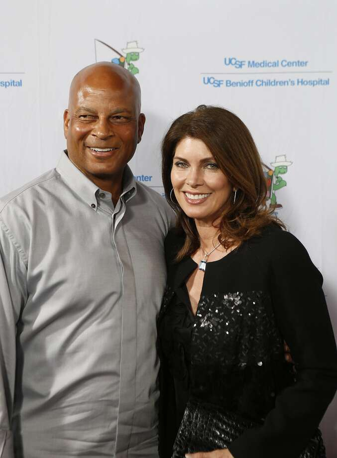"Ronnie Lott and his wife, Karen Lott, pose for the photographers as celebrities arrived for the Painted Turtle and UCSF Medical Center benefit, ""A Starry Evening of Music Comedy, and Surprises,"" at Davies Symphony Hall in San Francisco, Calif., on Monday, March 10, 2014. Photo: Carlos Avila Gonzalez, The Chronicle"