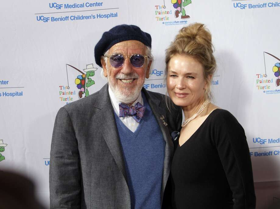 "Lou Adler poses with Renee Zellweger as celebrities arrived for the Painted Turtle and UCSF Medical Center benefit, ""A Starry Evening of Music Comedy, and Surprises,"" at Davies Symphony Hall in San Francisco, Calif., on Monday, March 10, 2014. Photo: Carlos Avila Gonzalez, The Chronicle"