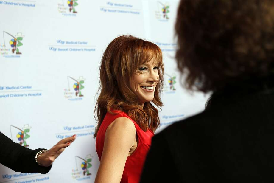 "Kathy Griffin smiles for the cameras as celebrities arrived for the Painted Turtle and UCSF Medical Center benefit, ""A Starry Evening of Music Comedy, and Surprises,"" at Davies Symphony Hall in San Francisco, Calif., on Monday, March 10, 2014. Photo: Carlos Avila Gonzalez, The Chronicle"