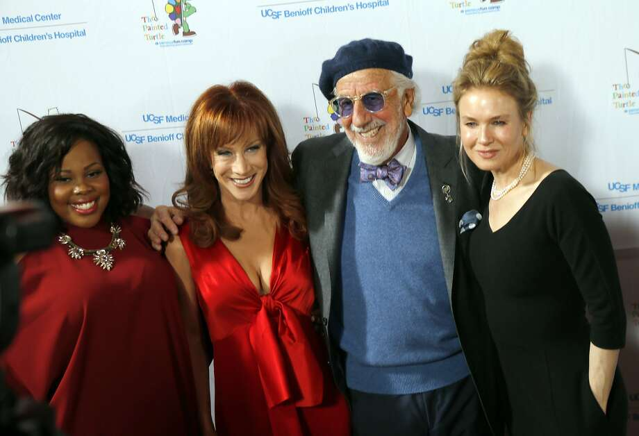 "L-R, Amber Riley, Kathy Griffin, Lou Adler, and Renee Zellweger pose for photographers as celebrities arrived for the Painted Turtle and UCSF Medical Center benefit, ""A Starry Evening of Music Comedy, and Surprises,"" at Davies Symphony Hall in San Francisco, Calif., on Monday, March 10, 2014. Photo: Carlos Avila Gonzalez, The Chronicle"