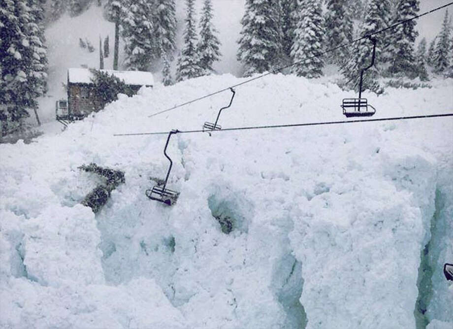A damaged ski lift, pictured in a photo provided by Crystal Mountain.