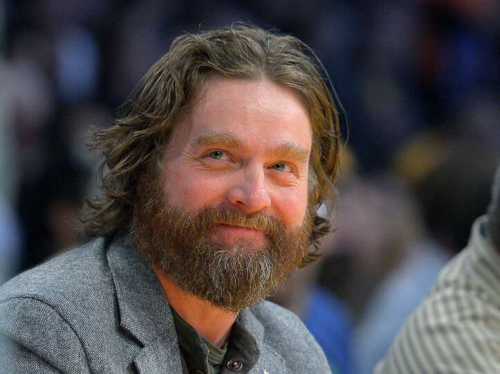 FILE - In this Feb. 28, 2013 file photo, actor Zach Galifianakis watches the Los Angeles Lakers play