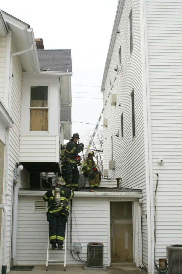 A fire at a combination commercial and apartment building on Greenwood Avenue forced the evacuation of a dozen residents and closed the road for nearly three hours on Monday, March 10, 2014. Photo: Rob Fish, Bethel Fire Department