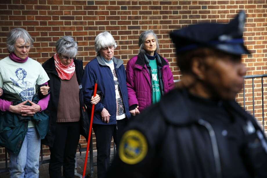 Protesters demonstrating in opposition to the proposed Keystone XL oil pipeline, Monday, March 10, 2014, wait to be detained for blocking a door to a federal building in Philadelphia. The protestors say the pipeline would contribute to global warming. (AP Photo/Matt Rourke) Photo: Matt Rourke, AP