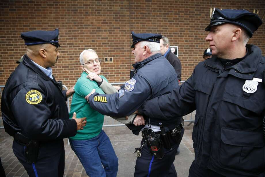 Police detain a protester demonstrating in opposition to the proposed Keystone XL oil pipeline, Monday, March 10, 2014, outside the Federal Building in Philadelphia. The protestors say the pipeline would contribute to global warming. (AP Photo/Matt Rourke) Photo: Matt Rourke, AP