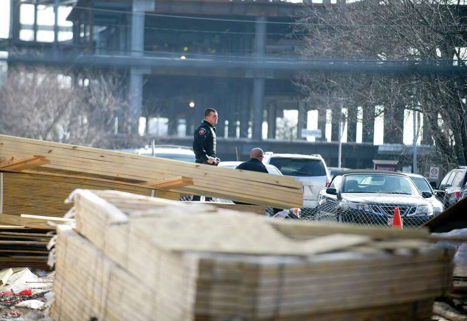 Police officers stand at the site of construction of a new public housing complex on Merrell Ave. in Stamford, Conn., where a construction worker fell two stories on Tuesday, March 11, 2014. Photo: Lindsay Perry / Stamford Advocate
