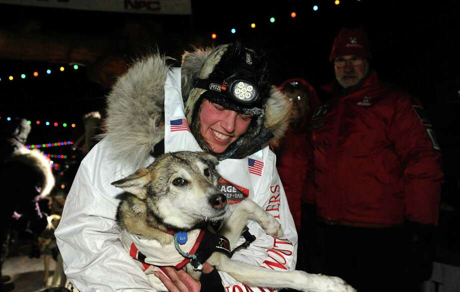 Aliy Zirkle with her lead dog after finishing in second place behind race winner Dallas Seavey in the 2014 Iditarod Trail Sled Dog Race on Tuesday, March 11. Photo: Bob Hallinen, McClatchy-Tribune News Service / Anchorage Daily News