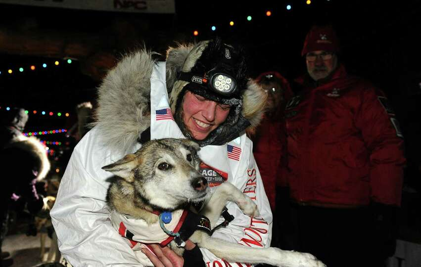 Aliy Zirkle with her lead dog after finishing in second place behind race winner Dallas Seavey in th