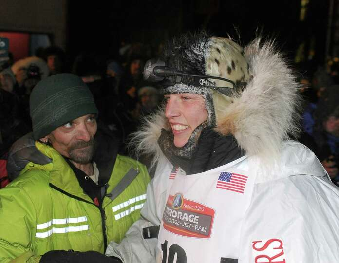 Four time Iditarod champion Lance Mackey and Aliy Zirkle talk after Zirkle finished in second place