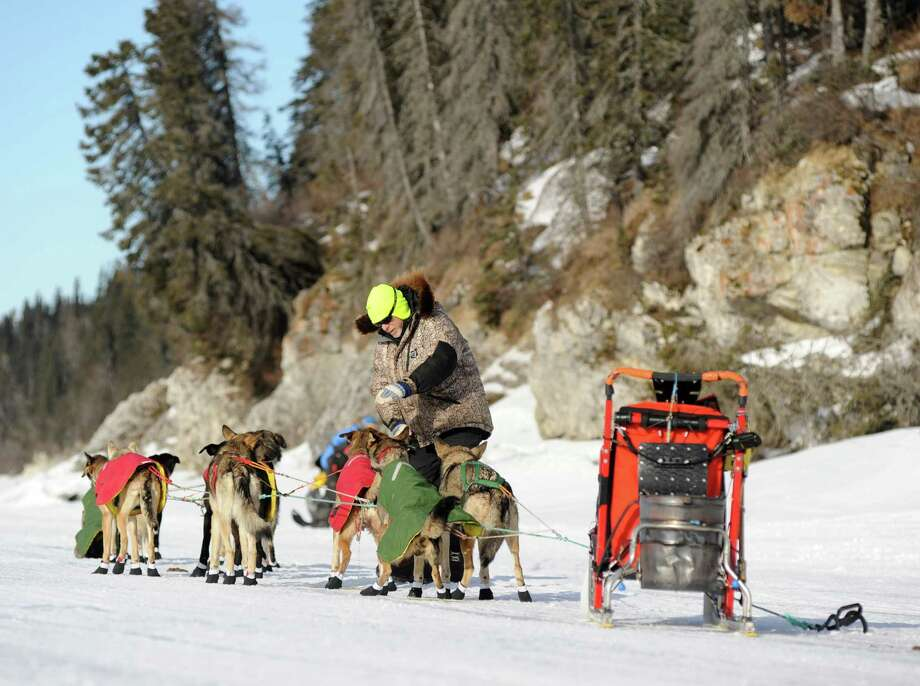 Iditarod musher Jeff King, from Denali, Alaska, is the first musher to leave the White Mountain checkpoint. Photo: Bob Hallinen, Associated Press / Anchorage Daily News