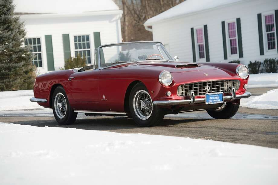 The 1961 Ferrari 250 GT Series II Cabriolet pulled in $1.76 million. Photo: Darin Schnabel, 2014 Courtesy O