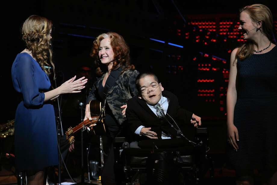 Bonnie Raitt on stage with kids from The Painted Turtle camp at the UCSF Medical Center and The Painted Turtle Present A Starry Evening of Music, Comedy & Surprises at Davies Symphony Hall on March 10, 2014 in San Francisco, California. Photo: Steve Jennings, Getty Images For The Painted Tur
