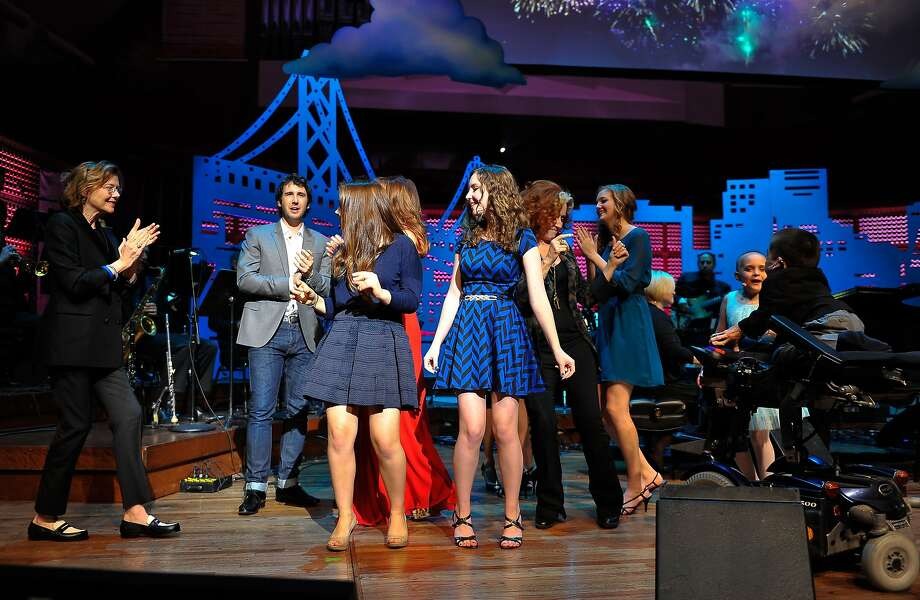 Annette Bening and Josh Groban (L) dance on stage with kids from The Painted Turtle camp at the UCSF Medical Center and The Painted Turtle Present A Starry Evening of Music, Comedy & Surprises at Davies Symphony Hall on March 10, 2014 in San Francisco, California.  Photo: Steve Jennings, Getty Images For The Painted Tur