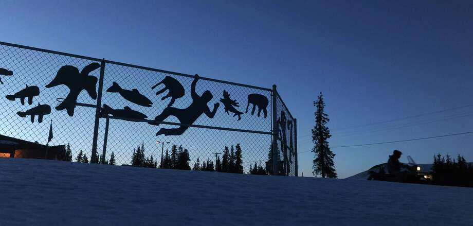 Art works designed by the school children adorns the fence at the White Mountain School at the White Mountain checkpoint during the Iditarod Trail Sled Dog Race on Monday, March 10, 2014. (AP Photo/The Anchorage Daily News, Bob Hallinen)    ORG XMIT: AKAND115 Photo: Bob Hallinen, AP / The Anchorage Daily News