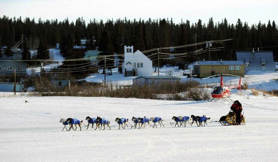 Mitch Seavey arrives at the White Mountain checkpoint during the Iditarod Trail Sled Dog Race on Mon