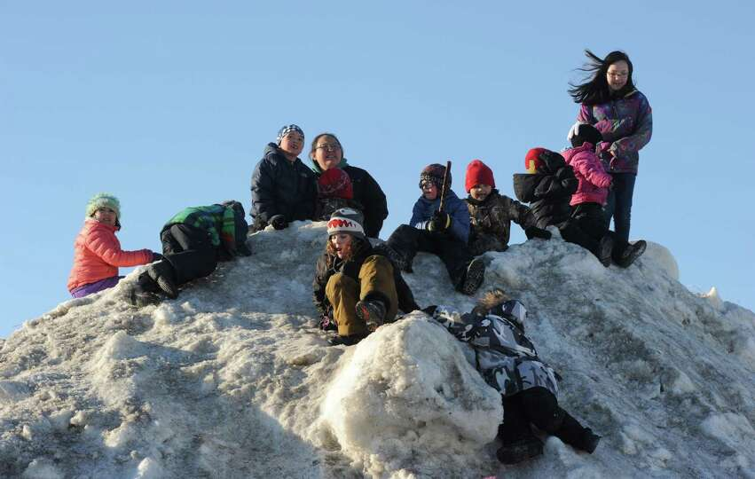 Race fans wait for Aliy Zirkle to drive her dog team into the Unalakleet checkpoint. Zirkle is the f