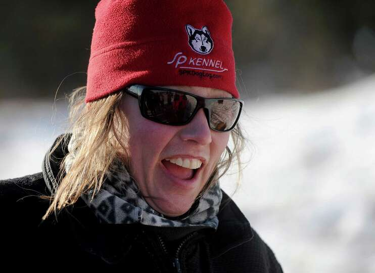 Iditarod musher Aliy Zirkle, from Two Rivers, Alaska, reacts to the problems with trail leaving the