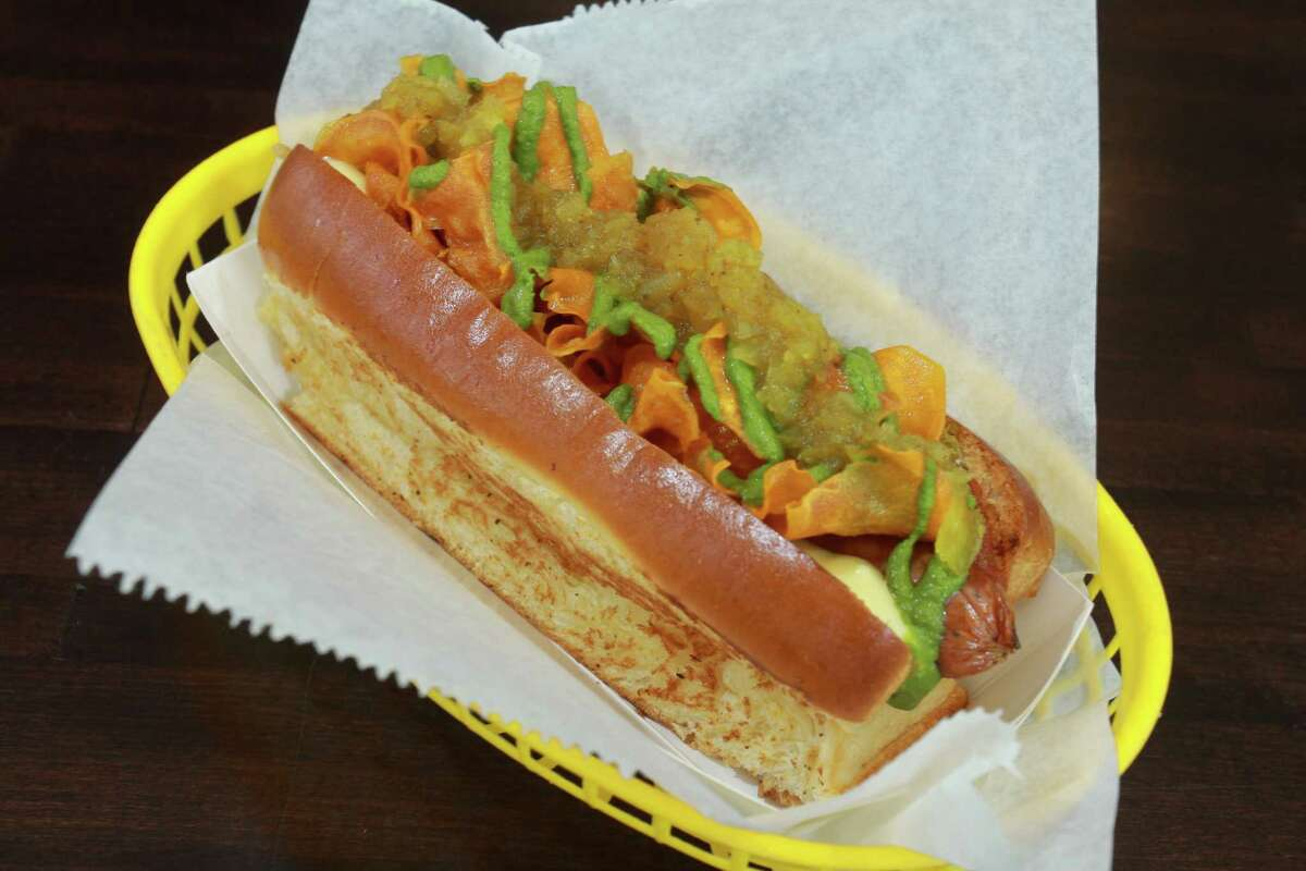 (For the Chronicle/Gary Fountain, March 6, 2014) The Curryous Frank at Good Dog restaurant