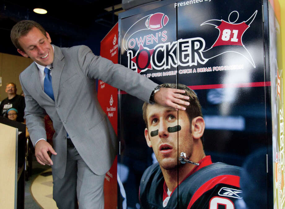 """Houston Texans tight end Owen Daniels reaches out to Owen's Locker  during an unveiling ceremony at Texas Children's Hospital June 22, 2011, in Houston. The """"Locker"""" put together on behalf of Daniels' Catch a Dream Foundation, is designed to enrich the lives of patients by providing them and their families access to notebook computers, DVD players, gaming systems and other items to help pass the time while undergoing treatment and recovery. Photo: Brett Coomer, Houston Chronicle / © 2011 Houston Chronicle"""