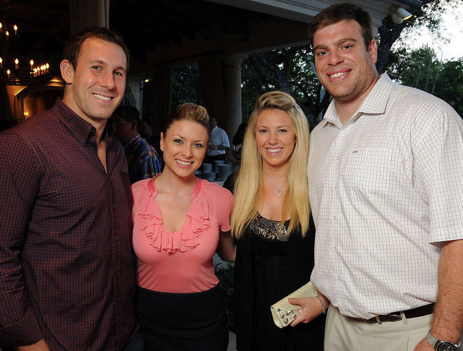 Owen Daniels and  Angela Mecca with Jennifer and Eric Winston at the Gathering of Champions benefitting Houston Children's Charity at the home of Paige and Tilman Fertitta April 13, 2011. Photo: Dave Rossman, For The Chronicle / Freelance