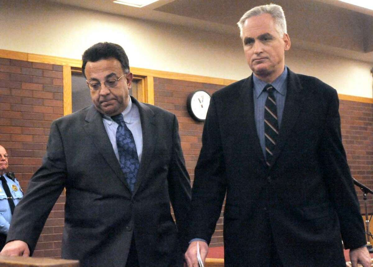 Joseph DaSilva Jr. leaves the courtroom followed by his attorney, Eugene Riccio, in Danbury Superior Court, on Tuesday, Feb.9,2010.