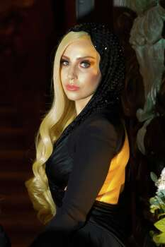 FILE - This Jan. 19, 2014 file photo shows Lady Gaga at the showing of the Atelier Versace Spring-Summer 2014 Haute Couture fashion collection in Paris. South By Southwest has slipped into hyperdrive as the music portion of the annual conference and festival opens this week. Kanye West and Jay Z have announced they're headed to Austin, Texas, and Lady Gaga will be a keynote speaker. Photo: Zacharie Scheurer, AP / AP