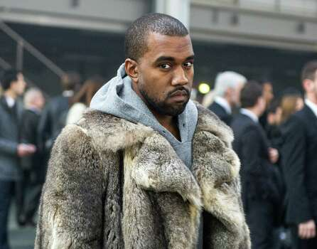 FILE - This Jan. 17, 2014 file photo shows singer Kanye West as he arrives for the Givenchy men's Fall-Winter 2014-2015 fashion collection in Paris. South By Southwest has slipped into hyperdrive as the music portion of the annual conference and festival opens this week. Kanye West and Jay Z have announced they're headed to Austin, Texas. They will appear along with Kendrick Lamar, Lil Wayne, Rick Ross, Nas, 50 Cent, Tyler, the Creator, Earl Sweatshirt, 2 Chainz, Future, Action Bronson, Childish Gambino and ScHoolboy Q, after his new album opened at No. 1. Photo: Zacharie Scheurer, AP / AP