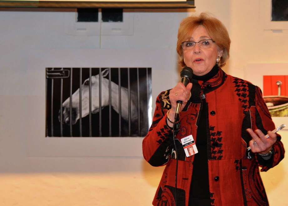 "New Canaan High School Visual Arts teacher Jeanne McDonagh, the driving force behind ""Through Our Eyes"" Art Exhibition at the Carriage Barn Arts Center, addresses the crowd last Friday evening, February 28, 2014. Photo: Jeanna Petersen Shepard / New Canaan News freelance"