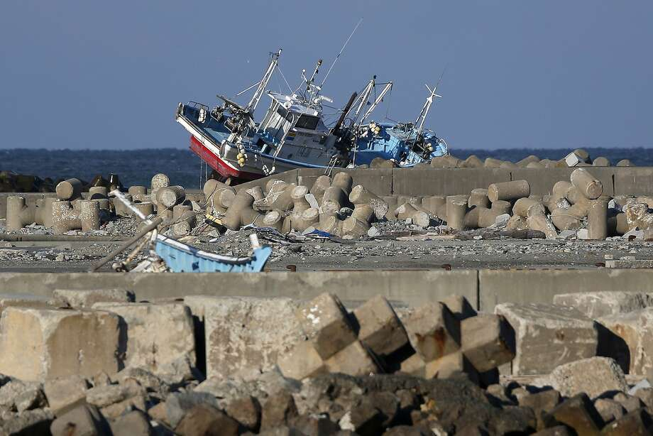 A fishing vessel swept ashore by the tsunami following the March 2011 earthquake sits abandoned on a breakwater in Namie, Fukushima Prefecture, Japan, on Monday, March 10, 2014. March 11 marks three years since Japan's deadliest earthquake in 2011, a magnitude-9 temblor that triggered a tsunami in northeastern Japan, leaving about 19,000 people dead or missing and hundreds of thousands homeless as it wiped out entire towns.  Photo: Kiyoshi Ota, Bloomberg