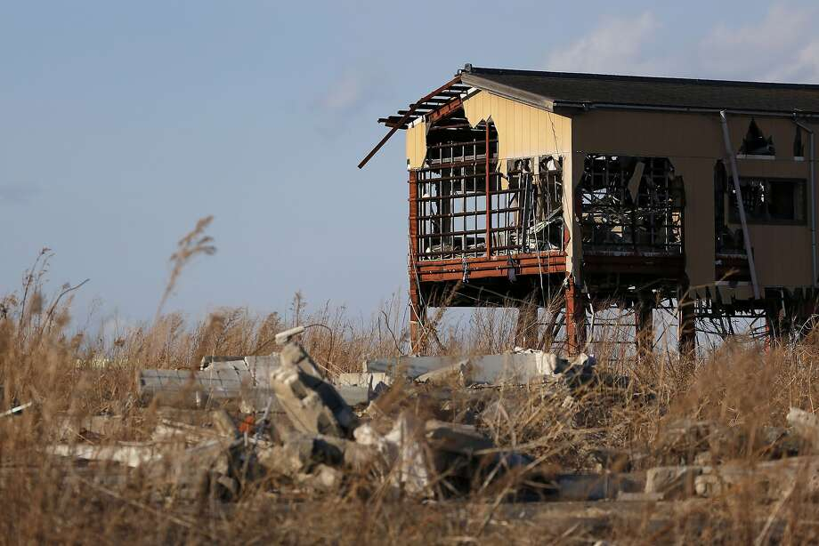 A building damaged by the tsunami following the March 2011 earthquake stands in Namie, Fukushima Prefecture, Japan, on Monday, March 10, 2014. March 11 marks three years since Japan's deadliest earthquake in 2011, a magnitude-9 temblor that triggered a tsunami in northeastern Japan, leaving about 19,000 people dead or missing and hundreds of thousands homeless as it wiped out entire towns.  Photo: Kiyoshi Ota, Bloomberg