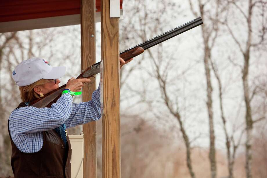Gaye Kelsey takes aim at the Greater Houston Gun Club for the Fine Art of Shooting. / JennyAntill
