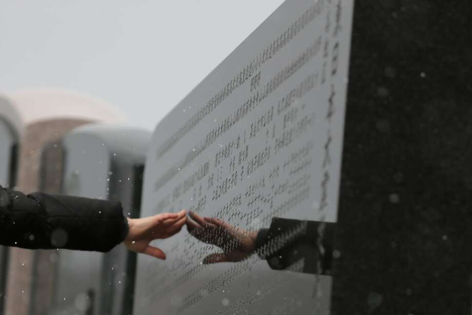 A woman touches a memorial engraved with the names of the victims at Okawa Elementary School on the three year anniversary of the earthquake and tsunami on March 11, 2014 in Ishinomaki, Miyagi prefecture, Japan. On March 11 Japan commemorates the third anniversary of the magnitude 9.0 earthquake and tsunami that claimed more than 18,000 lives, and subsequent nuclear disaster at the Fukushima Daiichi Nuclear Power Plant.  Photo: Yuriko Nakao, Getty Images