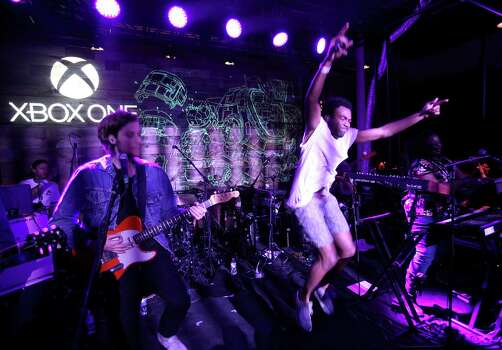 "IMAGE DISTRIBUTED FOR MICROSOFT - Childish Gambino performs for fans at the ""Titanfall"" on Xbox One launch event at SXSW on Monday, March 10, 2014, in Austin, Texas. (Photo by Hal Horowitz/Invision for Microsoft/AP Images) Photo: Hal Horowitz, Associated Press / Invision"
